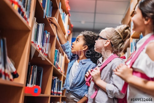 kids picking book shelf in library